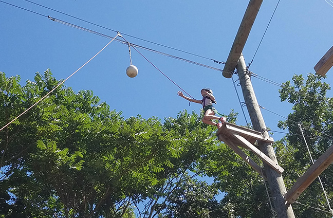 Camper doing the Leap of Faith